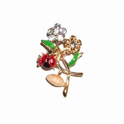 Brosa aurie cu flori magice si gargarita pentru noroc