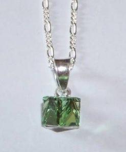 Cubul magic de culoare verde cu agatatoare din argint